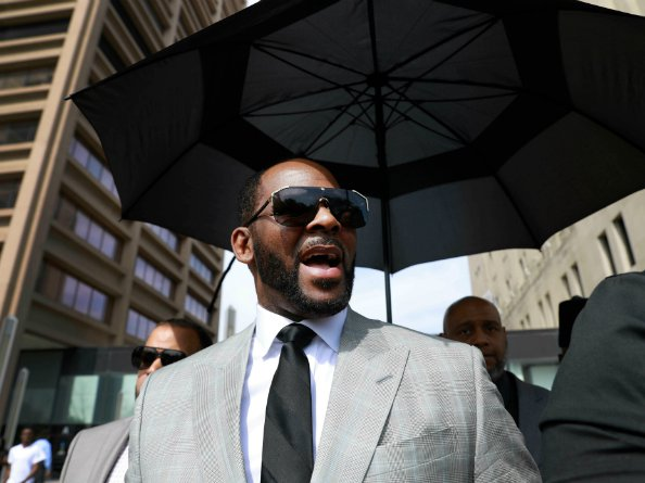 R. Kelly leaving a courthouse in Chicago after pleading not guilty to 11 sex-related charges last month