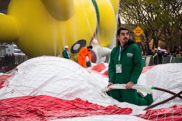 A team inflates a balloon for the Macy's Thanksgiving Day Parade